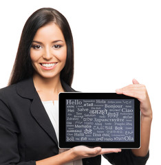 Young, confident and beautiful businesswoman with a tablet