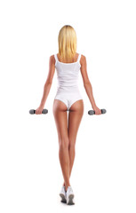 Young, sporty and fit girl pumping dumbbells isolated on white