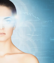Young woman with a digital hologram on her eye. Ophthalmology an