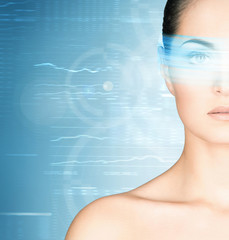Young and attractive woman from future with a laser hologram
