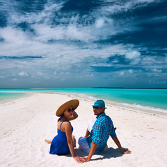 Couple in blue on a beach at Maldives