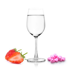 Glass of water Strawberry  and pills isolated on white backgroun