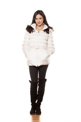 beautiful smiling girl posing with winter coat