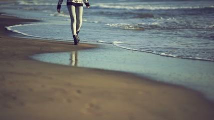 Teen girl enjoying nature on the beach