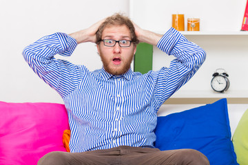 Shocked Man On The Couch