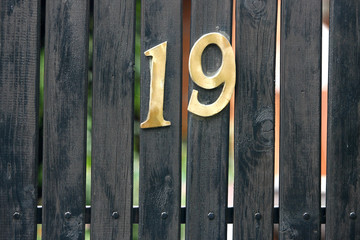 Nineteen Number Address House on Gate