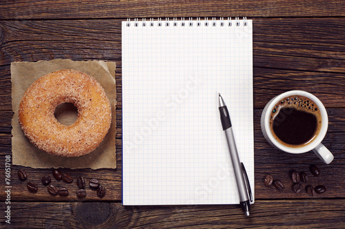 Foto op Canvas Koffie Notepad and coffee with donut