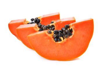 sliced papaya on a white background