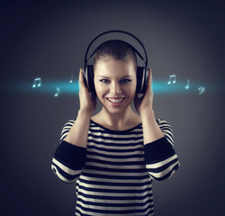 Woman listening music in earphones with musical sketch around