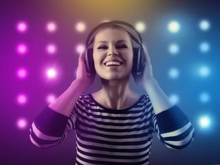 Female night club DJ enjoying music over club lights background