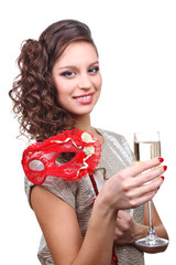 Beautiful girl with masquerade mask and glass of champagne in