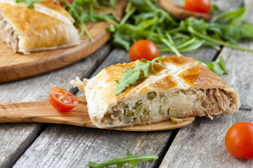 pie of puff pastry with tuna, rice and egg