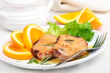 Grilled steak with orange sauce