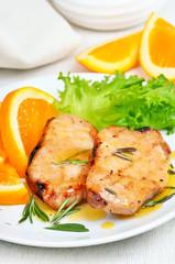 Pork cutlets with orange sauce