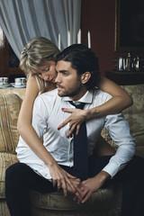 Beautiful fashion woman undressing elegant man