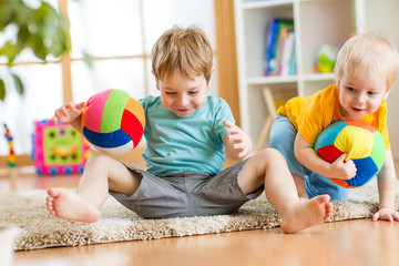 kids boys play with ball indoor