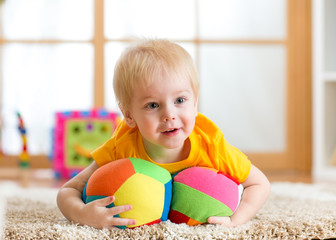 toddler boy playing with toys indoor