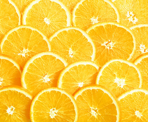 Background of heap fresh yellow lemon slices.