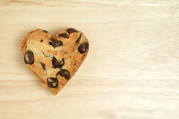 Heart sweet cookie on wood background