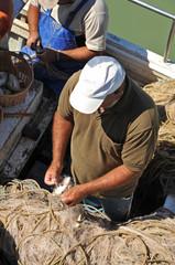 Fishermen preparing nets in the port, Chipiona, Spain