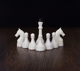The Chess and White queen on a wooden table.