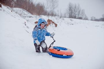 A boy is walking on snow