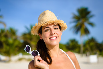 Woman on tropical summer caribbean vacation smiling