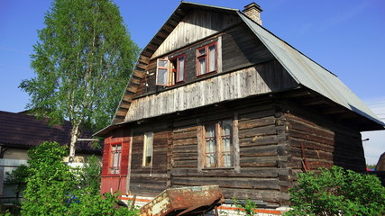 Wooden house in the village. 4K.