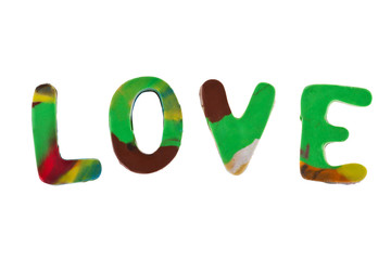 Plasticine letters forming word LOVE written on white