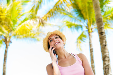 Woman on summer tropical vacation smartphone call