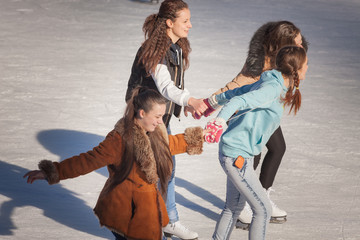 group of teenagers girl on the ice