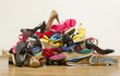 Big pile of colorful woman shoes. - 76063323
