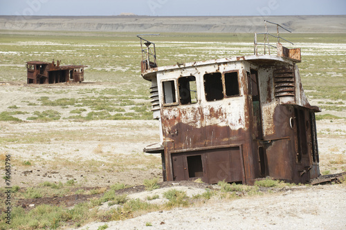 In de dag Droogte Remains of fishing boats at the sea bed of Aral sea, Kazakhstan