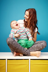 Laughing couple of boy and mother