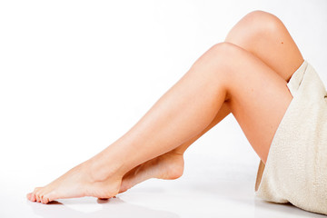 Smooth and slim female legs after depilation
