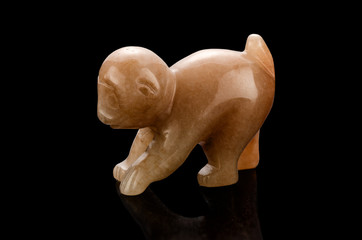 Carved aragonite monkey