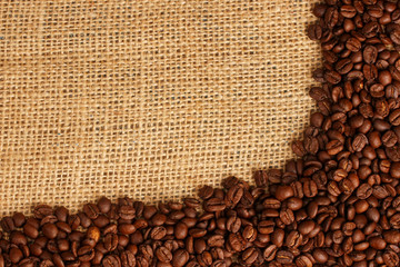 Coffee beans on brown sack background