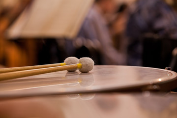 Drumsticks lying on the timpani