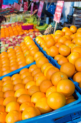 Many oranges in crates on market
