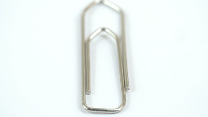 A metal paper clip on the table