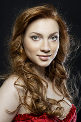 Portrait of a girl with red hair