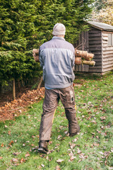 Gardener carrying wood
