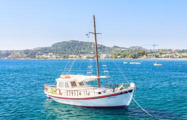 Yacht on the Mediterranean coast in the resort of Faliraki. Rhod