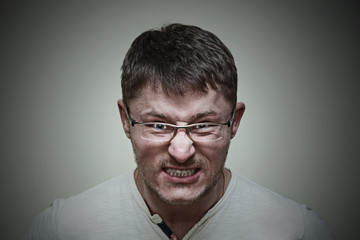 Aggressive brutal man with glasses. Emotional expression