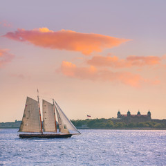 New York sailboat sunset and Ellis Island
