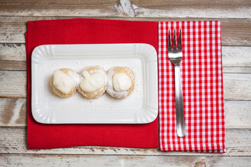 Cottage cheese dumplings with sour cream and powdered sugar