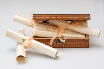 Wedding invitation card in rolls with wooden box