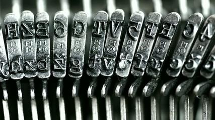 Typing. Metal types in the typewriter