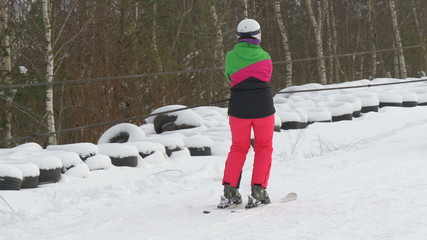 A lady in pink riding the ski lift