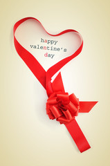 text happy valentines day and ribbon forming a heart